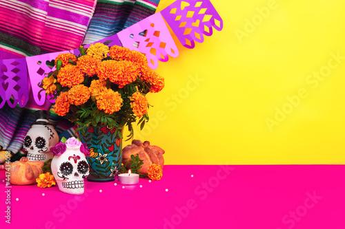Canvas-taulu Day of the dead, Dia De Los Muertos Celebration Background With sugar Skull, calaverita, marigolds or cempasuchil flowers, bread of death or Pan de Muerto with Copy Space