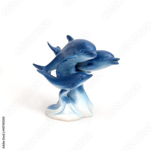Dolphin family. Figurine isolated on white background