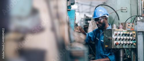 Fotografie, Tablou Male Engineer Working on laptop computer in Factory