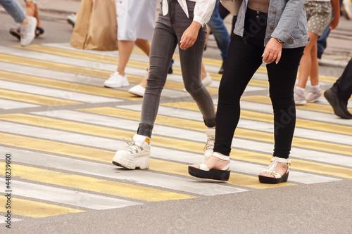pedestrians walking on a crosswalk Fototapeta