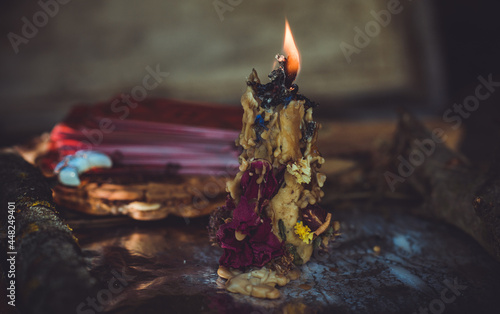 Canvas Print Candle burns on the altar, magic among candles, clean negative energy, wicca con