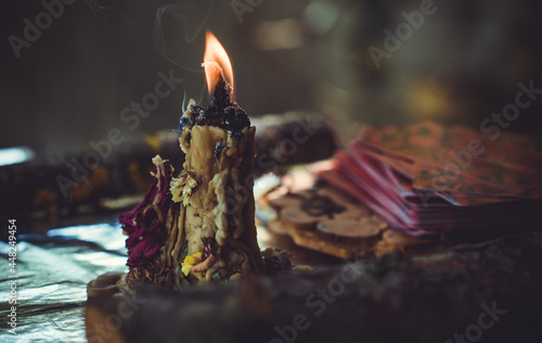Wallpaper Mural Candle burns on the altar, magic among candles, clean negative energy, wicca con