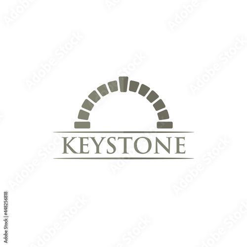Valokuvatapetti Key Stone Logo Design. Keystone Vector Illustration.