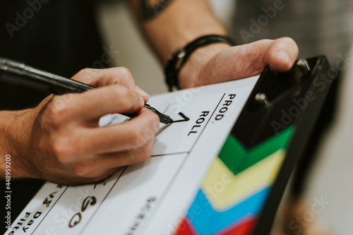 Photo Behind the scenes with a clapper board
