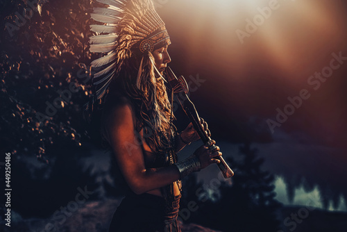 Photo beautiful shamanic girl playing on shaman flute in the nature.
