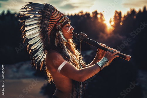 Wallpaper Mural beautiful shamanic girl playing on shaman flute in the nature.