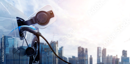 EV charging station for electric car in concept of green energy and eco power produced from sustainable source to supply to charger station in order to reduce CO2 emission Fototapet
