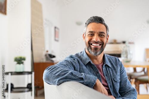 Obraz na plátně Happy mature indian man smiling at home