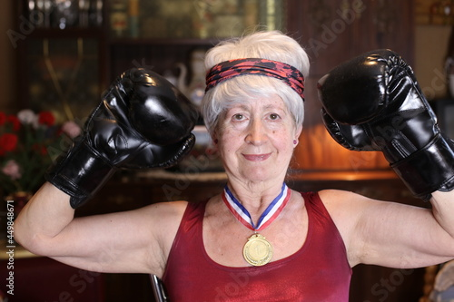 Wallpaper Mural Senior female boxer with a medal