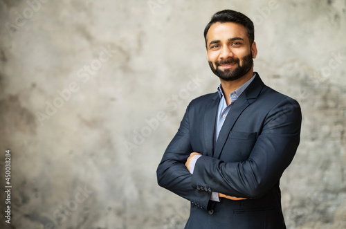 Canvas Print Smiling middle-age Indian high skilled leader in formal suit looks at the camera