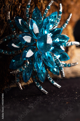 Canvas Closeup shot of a beautiful blue brooch in the shape of a flower