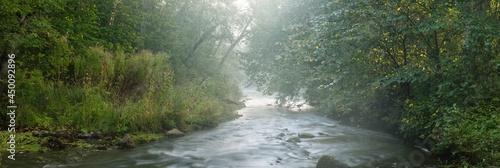 Obraz na plátně Wild river in the dark forest at sunrise