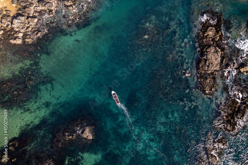 boat in the sea Fotobehang