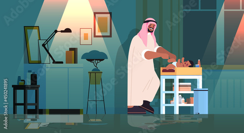 Fotografia sad arab father changing diaper to his little son fatherhood parenting concept d