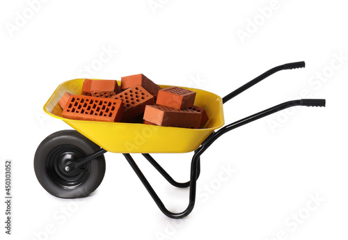 Canvas Pile of red bricks in wheelbarrow on white background