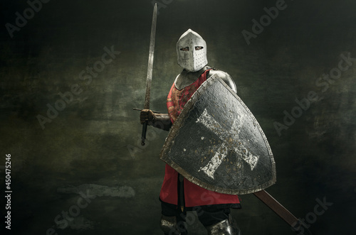 Obraz na plátne One medeival warrior or knight in armor and helmet with shield and sword