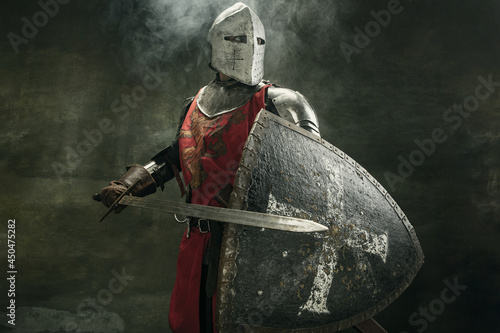 Fotografia, Obraz One medeival warrior or knight in armor and helmet with shield and sword