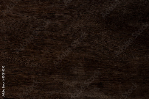 Fotografiet Dark brown wood and uneven surfaces for texture and copy space in background