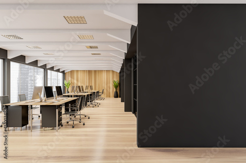 Slika na platnu Panoramic office with places for work, wooden floors and empty black wall