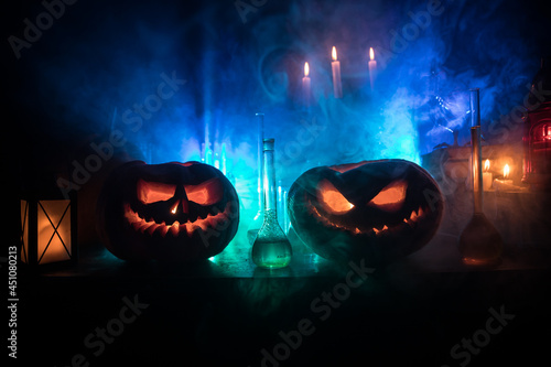 Canvas-taulu Halloween still-life background with different elements on dark toned foggy background