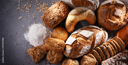 Assorted bakery products including loafs of bread and rolls