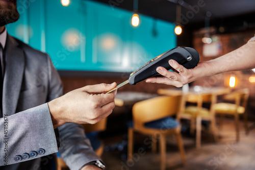Fotografia Hands holding a payment terminal