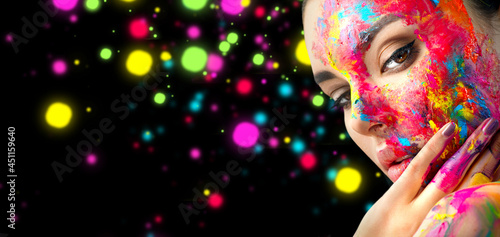 Fashion Art Model Girl colorful face paint. Beauty art portrait, beautiful woman with painting smears, abstract makeup. Vivid paint make-up, bright colors. Multicolor creative make-up.