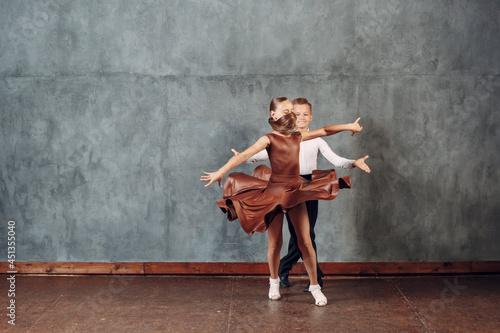 Canvas Young couple boy and girl dancing in ballroom dance Samba.