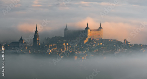 Foto Aerial view of the old European city with the ancient castle Alcazar of Toledo a