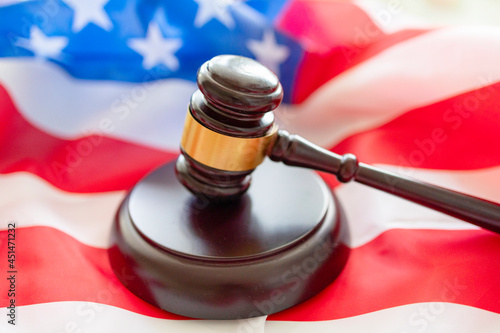 Obraz na płótnie brown gavel against the background of the American flag, the concept of a fair j