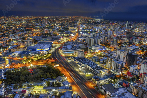 Obraz na plátně Cityscape of Santo Domingo surrounded by lights at night in the Dominican Republ