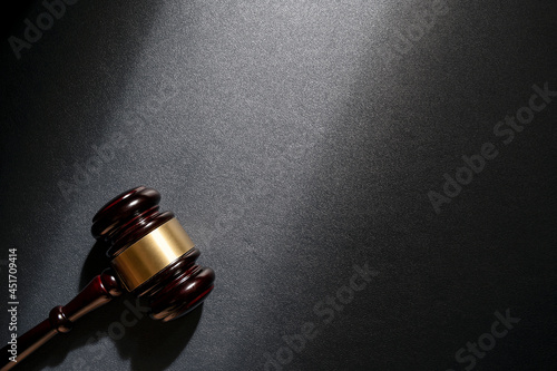 Fotografie, Obraz Judge's gavel on black leathe background, top view. Law concept.