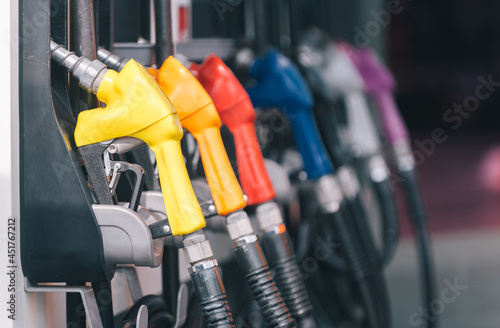 Canvas Print yellow red blue orange color fuel gasoline dispenser background, fuel pumps at a gas station