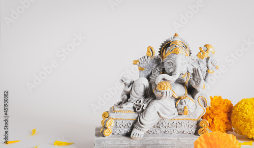 Canvas Print Happy Ganesh Chaturthi festival, Lord Ganesha statue with beautiful texture on white background, Ganesh is hindu god of Success