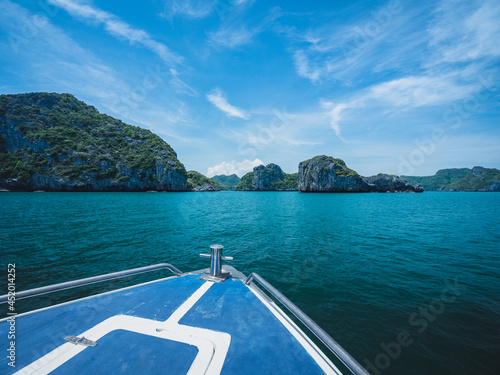Stampa su Tela View from speed boat's prow heading to stunning rock formation islands