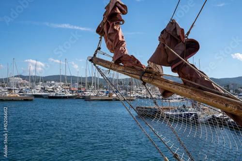 Fototapeta Moored nautical vessels at sea port San Antonio de Portmany, Balearic Islands, Ibiza, Spain