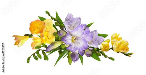 Obraz na płótnie Purple freesias yellow rudbeckia and chrysanthemum flowers in a line floral arra