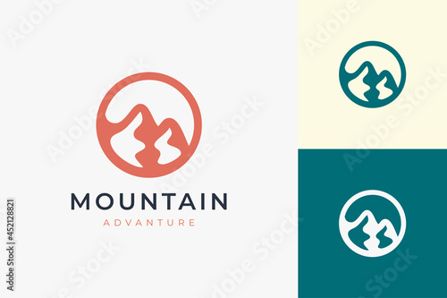 Fotografering Hiking or climbing logo template in simple and modern mountain shape