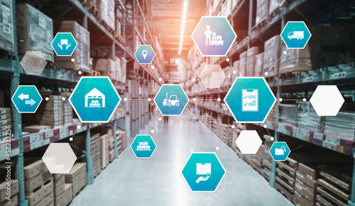 Obraz na płótnie Smart warehouse management system with innovative internet of things technology to identify package picking and delivery