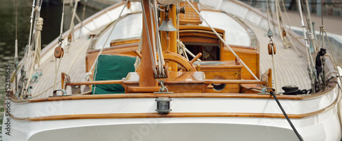 Fotografia Expensive retro sailing boat (ketch) moored to a pier in a new yacht marina