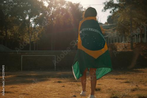 Obraz na plátně Patriot woman with brazil flag at sunset.