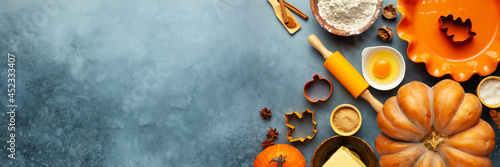 Photo Concept homemade fall baking with pumpkin, food ingredients, spices and kitchen utencil