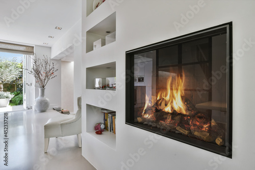 Fototapeta Stylish fireplace in a spacious living room