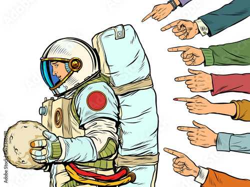 Fotografering A guilty astronaut with a planet in his hands
