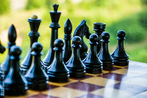 Fotografia Black chess pieces on a chessboard. Game of chess