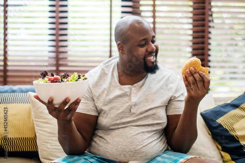 Obraz na płótnie Man chosing what to eat