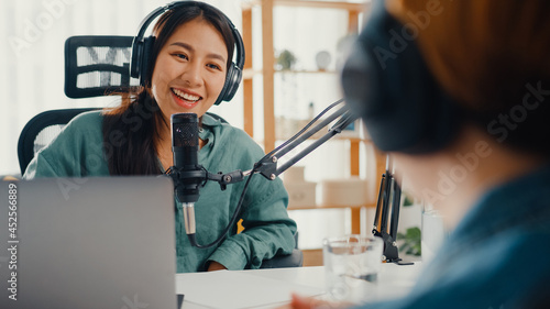 Canvastavla Asia girl radio host record podcast use microphone wear headphone interview celebrity guest content conversation talk and listen in her room