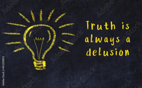 Slika na platnu Black chalkboard with a bulb sketch and smart quote