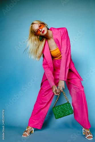 Fashionable woman wearing trendy fuchsia color suit Fototapet