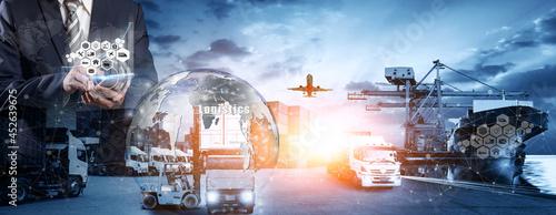 Fotografie, Obraz Businessman holding virtual interface panel of global logistics network distribu